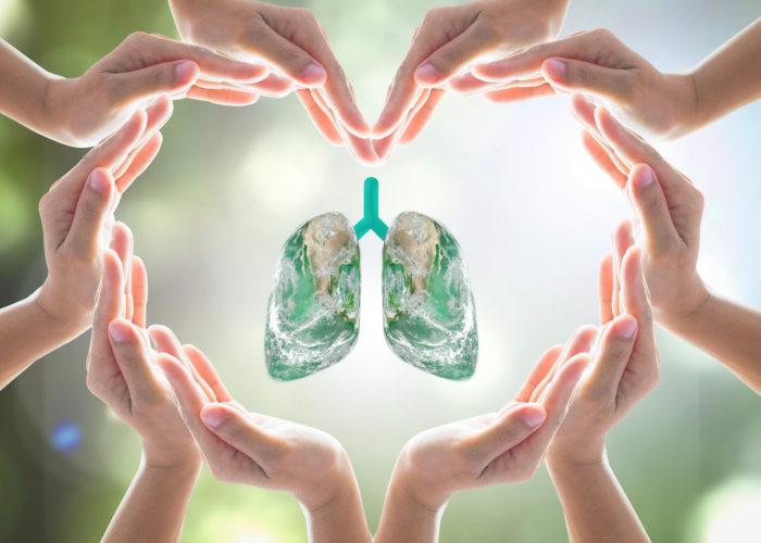 World no tobacco day campaign, lung in heart-shaped hand protection health care design logo concept. Element of this image furnished by NASA